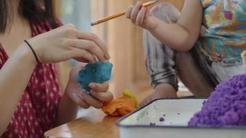 Slow motion of family playing with modelling clay