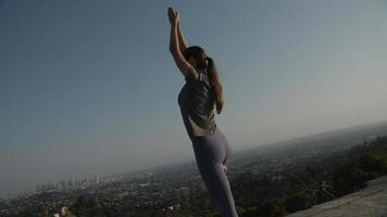 Slow motion of woman doing tree pose video