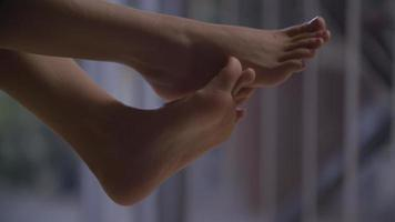 Slow motion of woman's bare feet