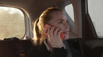 Slow motion of woman in taxi using on smartphone