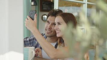 Slow motion of young couple taking selfie