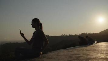 Slow motion of woman taking photo with camera at sunset video
