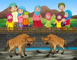 Scene with hyena and people at the zoo