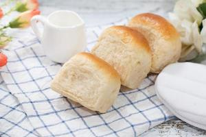 Fresh home made bread on white table background