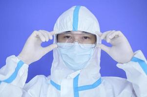 Asian man wearing PPE suit