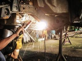 Welder repairs suspended car