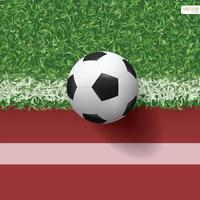 Soccer or football on green grass and running track vector