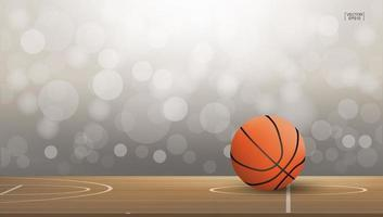 Basketball on court area with light blurred bokeh vector