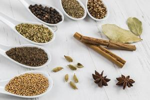 Selection of whole seeds and spices photo