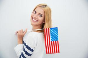 Girl holding USA flag photo