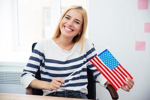 Woman holding US flag photo