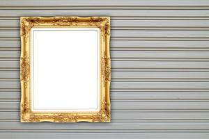 blank golden frame on metal wall