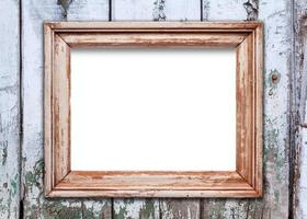 Empty frame on old wooden surface photo