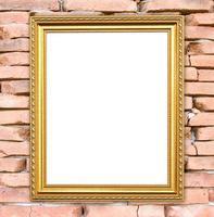 blank golden frame on brick stone wall photo