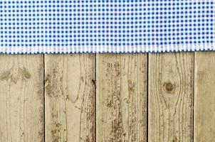 Blue tablecloth over wooden table