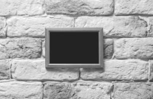 photo frame on brick wall