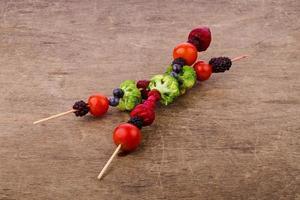 skewers of vegetables and berries