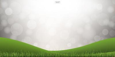 Green grass hill with light blurred bokeh vector