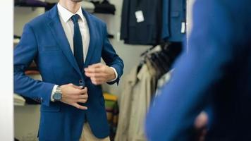 Handsome Man wearing suit at clothing store video