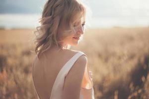Beautiful blond girl at the wheat field photo
