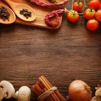 Assortment of vegetables and spices on wooden table
