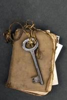 Rusty key and old book as a knowledge metaphor