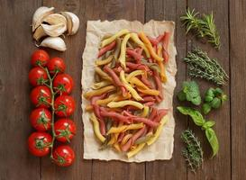 Colorful pasta, vegetables and herbs