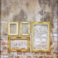 gold antique picture frame on the old brick wall background