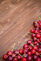 Sweet cherries on wooden background photo
