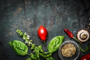 Basil and Tomatoes on rustic wooden background