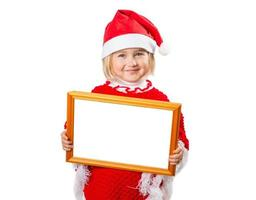 Little girl in hat Santa Claus holding frame with