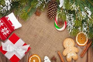 Christmas food, decor and gift box with snow fir tree
