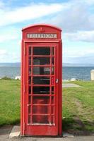 Telephone box by sea