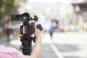 Filming an event with a video camera photo