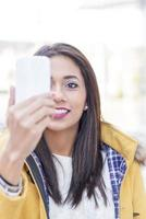 Portrait of smiling woman looking message in the phone. photo