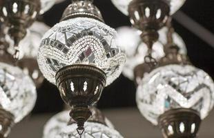 Brass chandelier with crystal.