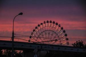 Ferris wheel red sky. photo