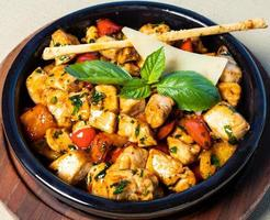 Cooked chicken with tomatoes photo
