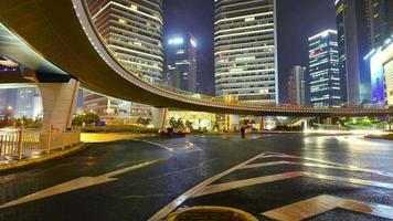 the light trails of city traffic on the modern buildings in shanghai china. timelapse & loopable video