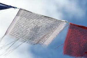 white and red prayer flag photo