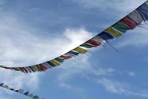 tibetian prayer flags in sky photo