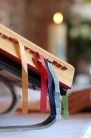 Holy bible with colorful bookmarks photo