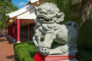 Stone lion statue in a Chinese temple