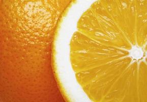 Orange fruit background with sliced orange