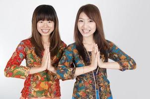 thai muslim in welcome gesture photo