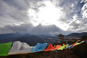 Meili Snow mountain and Tibetan prayer flags photo