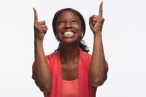 Young African American woman happy and excited photo