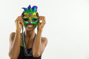 Woman wearing Mardi Gras mask with big smile 2