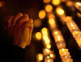 Praying in catholic church. Religion concept