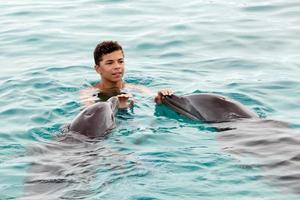 Boy and the dolphins photo